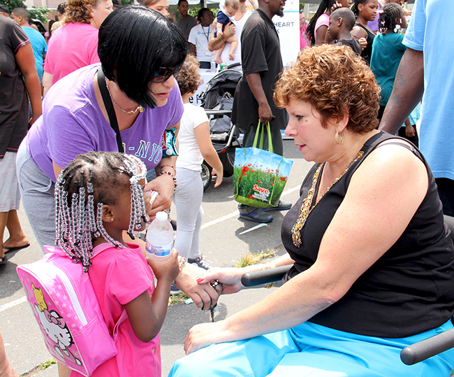 Sen. Christine M. Tartaglione  (right) talks about the upcoming school year with constituents at her annual community festivalon Thursday, Aug. 8, 2013.